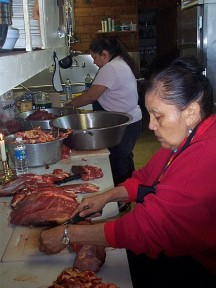 Carving buffalo meat, picture by C. Craig