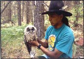 Terry Heemsah with juvenile spotted owl, picture by unknown